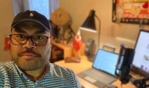 Tagata Pasifika Presenter John Pulu working from his bedroom. Photo: Supplied